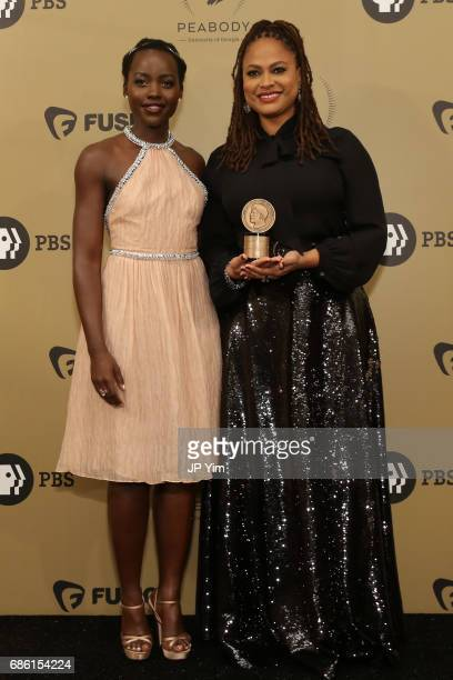 Lupita Nyong'o and Ava DuVernay pose with an award during The 76th Annual Peabody Awards Ceremony at Cipriani Wall Street on May 20 2017 in New York...