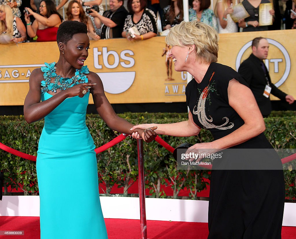 Lupita Nyong'o (L) and Emma Thompson arrive at the 20th Annual Screen Actors Guild Awards at the Shrine Auditorium on January 18, 2014 in Los Angeles, California.