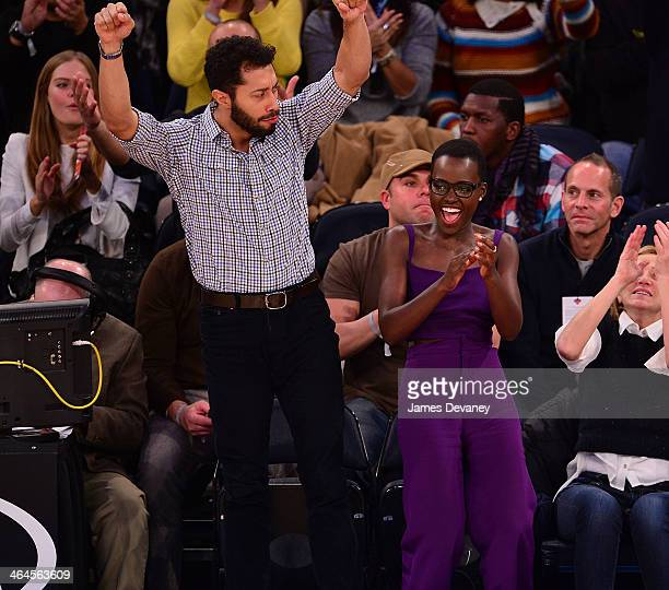 Lupita Nyong'o and guest attend the Philadelphia 76ers vs New York Knicks game at Madison Square Garden on January 22 2014 in New York City