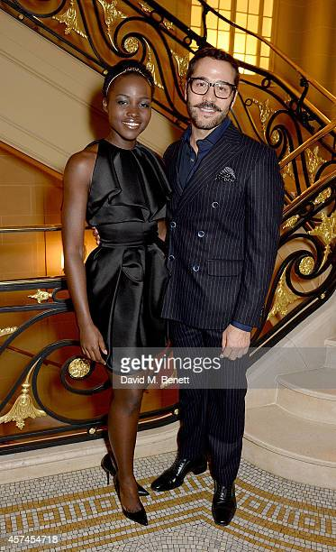 Lupita Nyong'o and Jeremy Piven attend the Sindika Dokolo Art Foundation dinner at Cafe Royal on October 18 2014 in London England