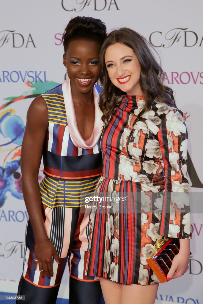 Lupita Nyong'o (L) and Micaela Erlanger attend at Alice Tully Hall, Lincoln Center on June 2, 2014 in New York City.