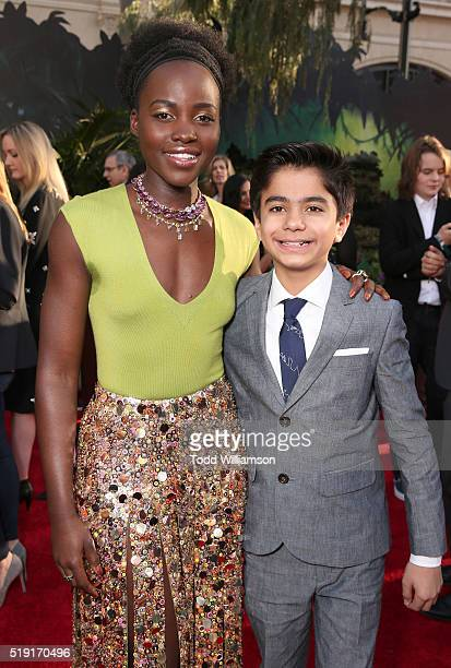 Lupita Nyong'o and Neel Sethi attend the premiere of Disney's 'The Jungle Book'at the El Capitan Theatre on April 4 2016 in Hollywood California