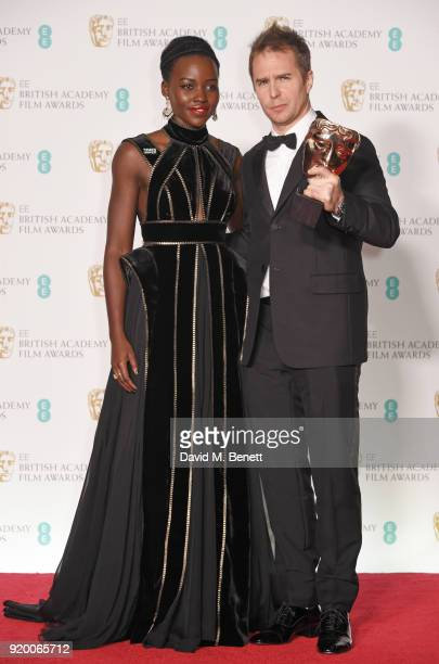 Lupita Nyong'o and Sam Rockwell winner of the Best Supporting Actor award for 'Three Billboards Outside Ebbing Missouri' pose in the press room...