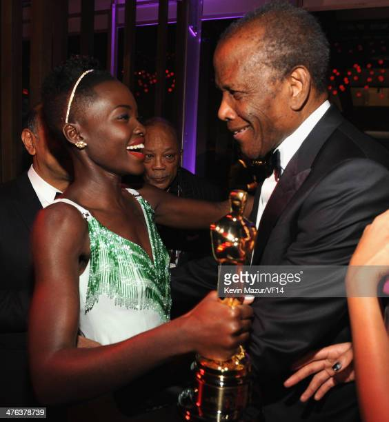 Lupita Nyong'o and Sidney Poitier attend the 2014 Vanity Fair Oscar Party Hosted By Graydon Carter on March 2 2014 in West Hollywood California
