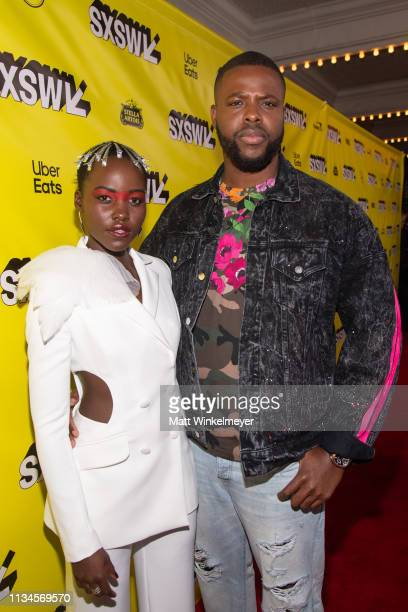"Lupita Nyong'o and Winston Duke attend the ""Us"" Premiere 2019 SXSW Conference and Festivals at Paramount Theater on March 08, 2019 in Austin, Texas."