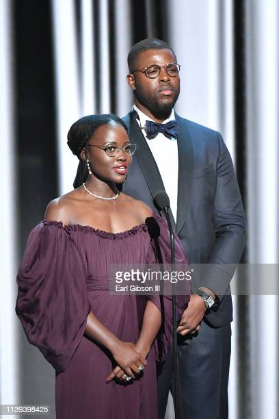 Lupita Nyong'o and Winston Duke speak onstage at the 50th NAACP Image Awards at Dolby Theatre on March 30, 2019 in Hollywood, California.