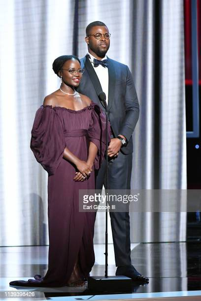 Lupita Nyong'o and Winston Duke speak onstage at the 50th NAACP Image Awards at Dolby Theatre on March 30 2019 in Hollywood California
