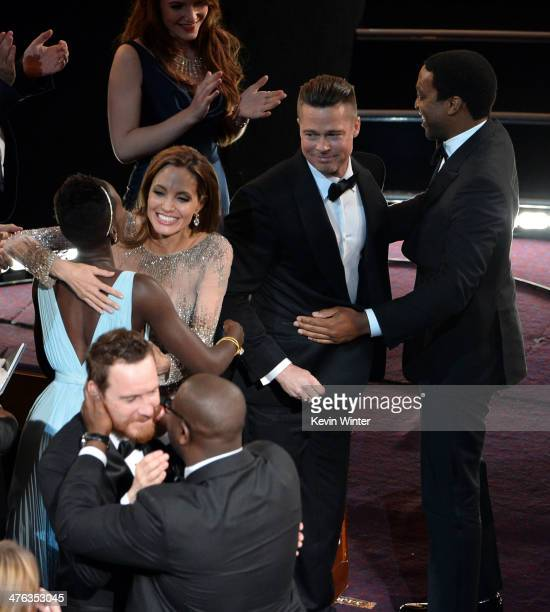 Lupita Nyong'o Angelina Jolie Sari Mercer producer Brad Pitt Chiwetel Ejiofor Michael Fassbender and director Steve McQueen celebrate as '12 Years A...