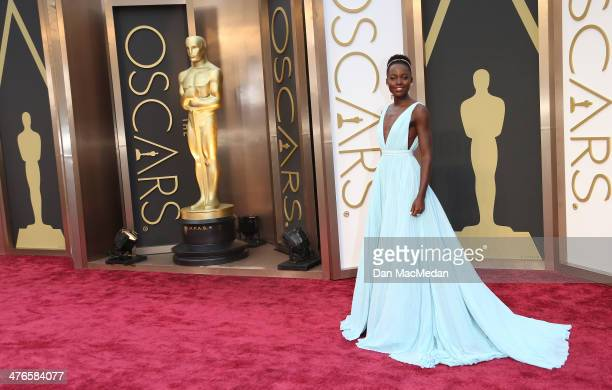 Lupita Nyong'o arrives at the 86th Annual Academy Awards at Hollywood Highland Center on March 2 2014 in Los Angeles California