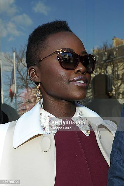 Lupita Nyong'o arrives at the Miu Miu show as part of the Paris Fashion Week Womenswear Fall/Winter 20142015 on March 5 2014 in Paris France