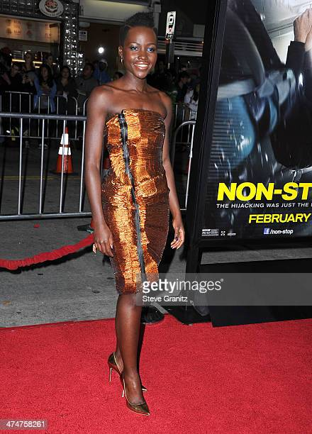 Lupita Nyong'o arrives at the 'NonStop' Los Angeles Premiere at Regency Village Theatre on February 24 2014 in Westwood California