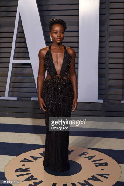 Lupita Nyong'o attends 2018 Vanity Fair Oscar Party Hosted By Radhika Jones Arrivals at Wallis Annenberg Center for the Performing Arts on March 4...
