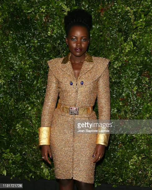 Lupita Nyong'o attends Charles Finch And CHANEL's 11th Annual PreOscar Awards Dinner at Polo Lounge at The Beverly Hills Hotel on February 23 2019 in...