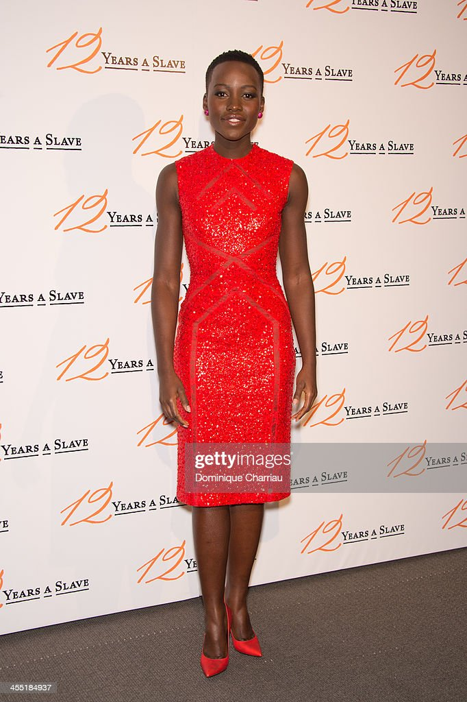 Lupita Nyong'o attends the '12 Years A Slave' Paris premiere at Cinema UGC Normandie on December 11, 2013 in Paris, France.