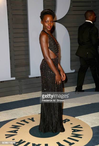 Lupita Nyong'o attends the 2018 Vanity Fair Oscar Party hosted by Radhika Jones at Wallis Annenberg Center for the Performing Arts on March 4 2018 in...