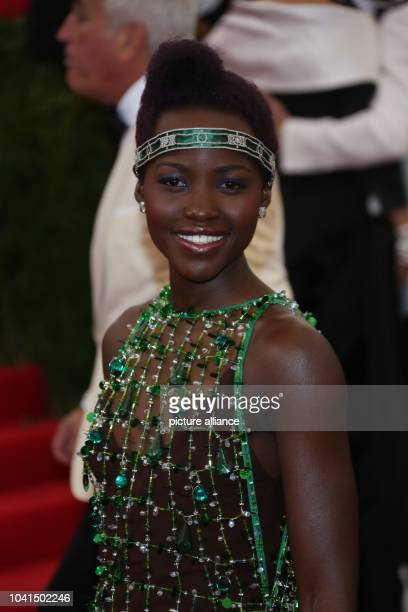 Lupita Nyong'o attends the 'Charles James Beyond Fashion' Costume Institute Gala at Metropolitan Museum of Art in New York USA 05 May 2014 Photo...