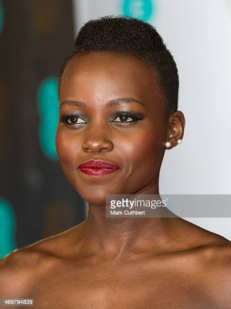 Lupita Nyong'o attends the EE British Academy Film Awards 2014 at The Royal Opera House on February 16 2014 in London England