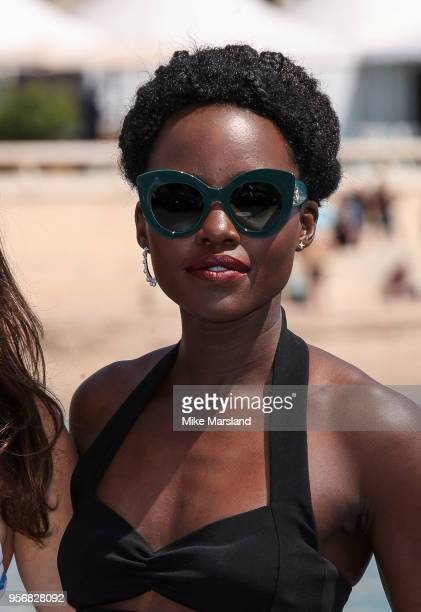 Lupita Nyong'o attends the photocall for 355 during the 71st annual Cannes Film Festival at Palais des Festivals on May 10 2018 in Cannes France