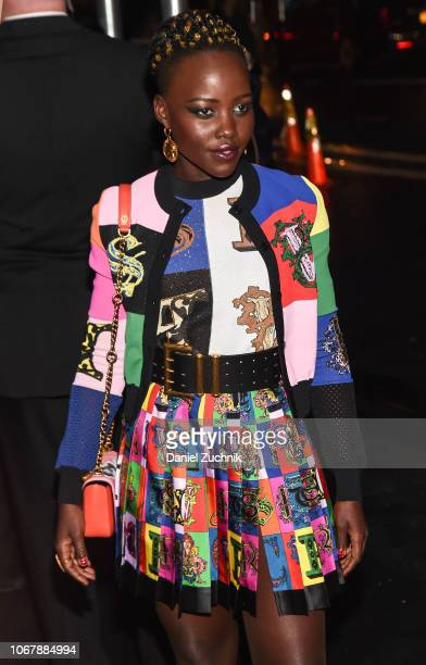 Lupita Nyong'o is seen wearing a Versace jacket and dress outside the Versace PreFall 2019 Collection on December 2 2018 in New York City