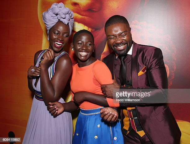 Lupita Nyong'o Madina Nalwanga and David Oyelowo attend the Premiere Of Disney's Queen Of Katwe at the El Capitan Theatre on September 20 2016 in...