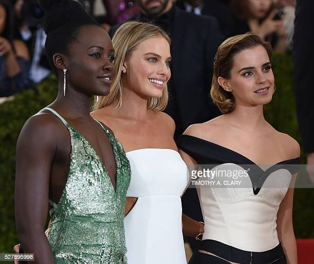 Lupita Nyong'o Margot Robbie and Emma Watson arrives at the Costume Institute Benefit at The Metropolitan Museum of Art May 2 2016 in New York / AFP...