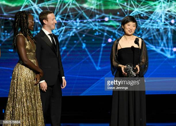 Lupita Nyong'o Mark Zuckerberg and Xiaowei Zhuang winner of Breakthrough Prize in Life Sciences speak onstage at the 2019 Breakthrough Prize at NASA...