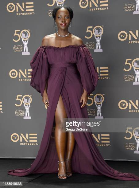 Lupita Nyong'o poses in the Press Room at the 50th NAACP Image Awards at Dolby Theatre on March 30, 2019 in Hollywood, California.