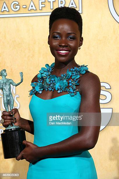 Lupita Nyong'o poses in the press room with the award for Outstanding Performance by a Female Actor in a Supporting Role for '12 Years a Slave' at...