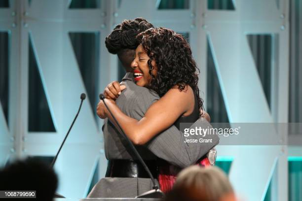 Lupita Nyong'o presents The Black Panther Scholarship to Kalis Coleman onstage during The Hollywood Reporter's Power 100 Women In Entertainment at...