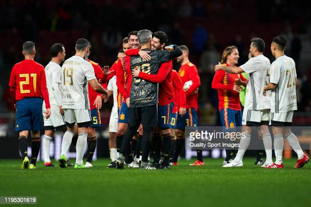 luque of Spanish National Team Legends salutes with Victor Baia of Goldstandard during a frienly match at Wanda Metropolitano on December 21 2019 in...