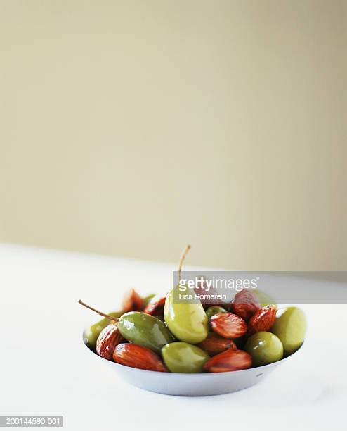 luques olives and almonds in dish - luques olive stock pictures, royalty-free photos & images