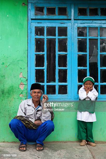 Lurah or Head of Village Kalikuning with his daughter at Dieng Plateau, Indonesia.
