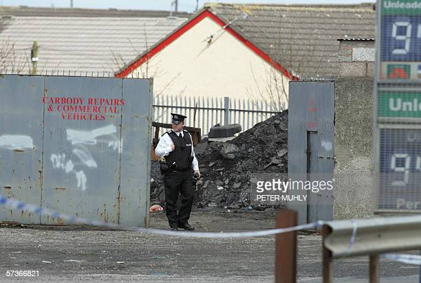 The PSNI close off a junk yard area around a petrol station in Lurgan Co Armagh Northern Ireland after a bomb was found 19 April 2006 AFP PHOTO/Peter...