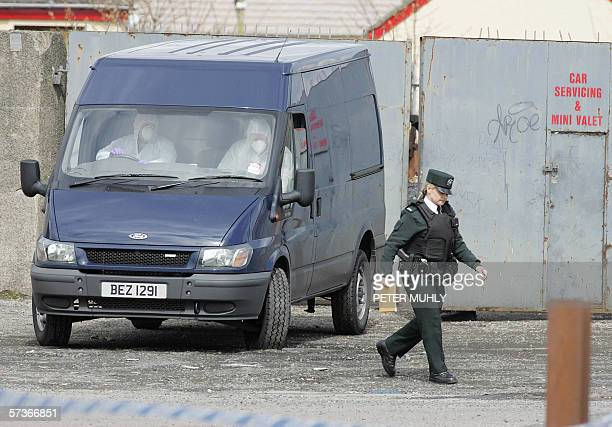 The PSNI Forensic team drive out of a car parts junk yard near a petrol station in Lurgan Co Armagh Northern Ireland after a bomb was found 19 April...