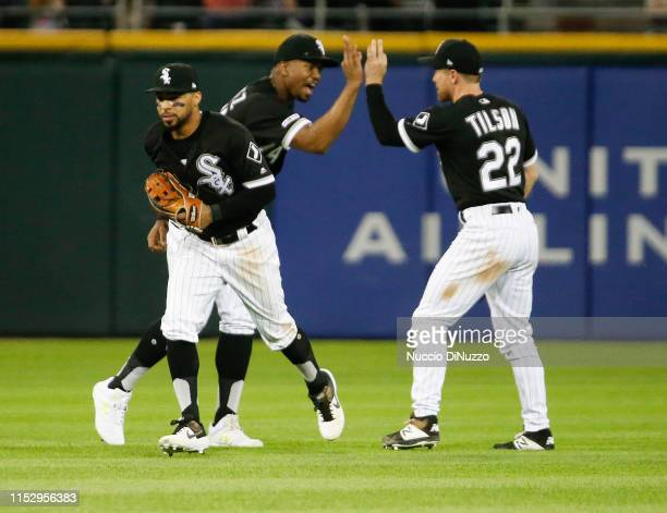 Lury Garcia Eloy Jimenez and Charlie Tilson of the Chicago White Sox celebrate their team's 61 win over the Cleveland Indians at Guaranteed Rate...