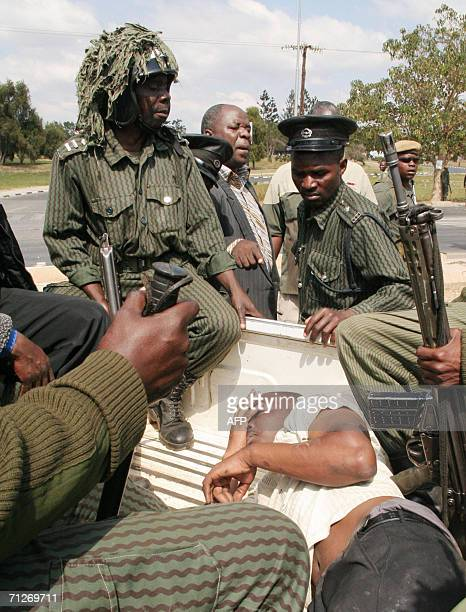 Zambian anti-riot police secure, 22 June 2006, a University student after demonstration to protest against the end of lectures more then two weeks...
