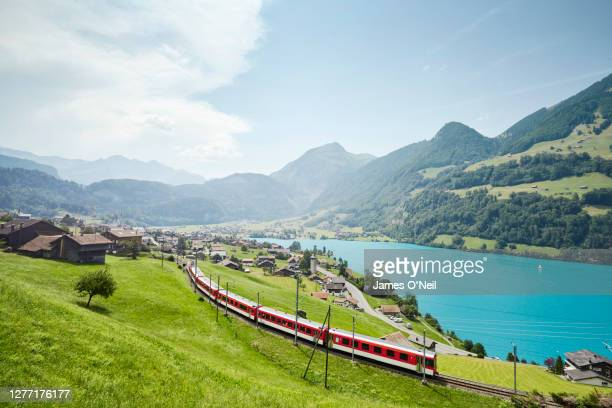 lush swiss landscape with commuter train and lake, lungern, obwalden, switzerland - switzerland stock pictures, royalty-free photos & images