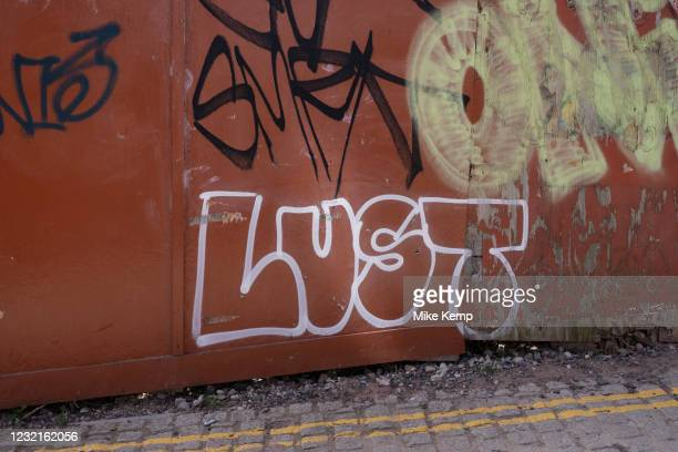 Lust graffiti on 30th March 2021 in Birmingham, United Kingdom. Lust is a psychological force producing intense desire for an object, or circumstance...