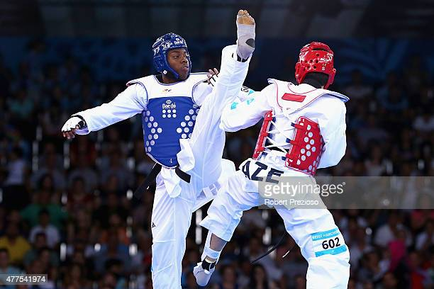 Lutalo Muhammad of Great Britain and Milad Beigi Harchegani of Azerbaijan compete in the Taekwondo Quarterfinals Men 80Kg during day six of the Baku...