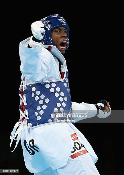 Lutalo Muhammad of Great Britain celebrates winning a point in the Men's 80kg Taekwondo Repechage bout on Day 14 of the London 2012 Olympic Games at...