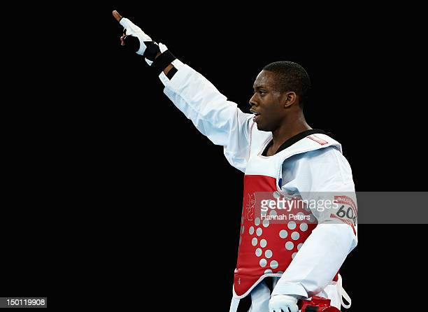 Lutalo Muhammad of Great Britain celebrates winning the Bronze medal in the Men's 80kg Taekwondo Bronze Medal Finals bout against Arman Yeremyan of...