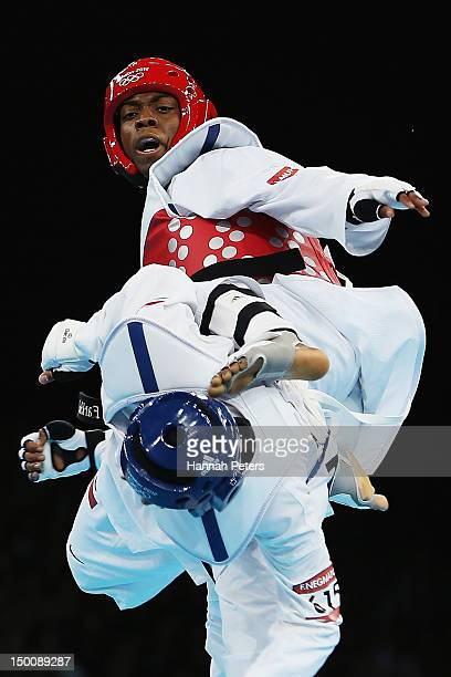 Lutalo Muhammad of Great Britain competes against Farkhod Negmatov of Tajikistan during the Men's 80kg Taekwondo Preliminary Round on Day 14 of the...