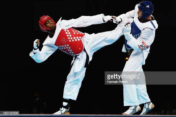 Lutalo Muhammad of Great Britain competes against Nicolas Garcia Hemme of Spain during the Men's 80kg Taekwondo quarterfinal on Day 14 of the London...