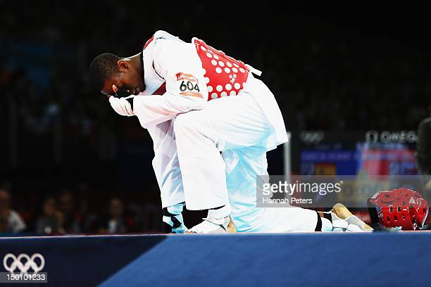 Lutalo Muhammad of Great Britain falls down dejected after losing to Nicolas Garcia Hemme of Spain during the Men's 80kg Taekwondo quarterfinal on...