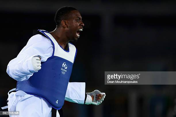 Lutalo Muhammad of Great Britain or Team GB celebrates after victory against Milad Beigi Harchegani of Azerbaijan during their Men's 80kg semifinal...