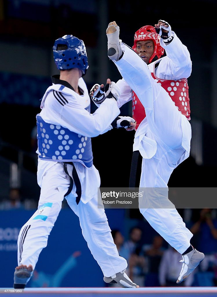 Lutalo Muhammed of Great Britain (red) and Roberto Botta of Italy (blue) compete during the Men's Taekwondo -80kg bronze medal final on day six of the Baku 2015 European Games at the Crystal Hall on June 18, 2015 in Baku, Azerbaijan.