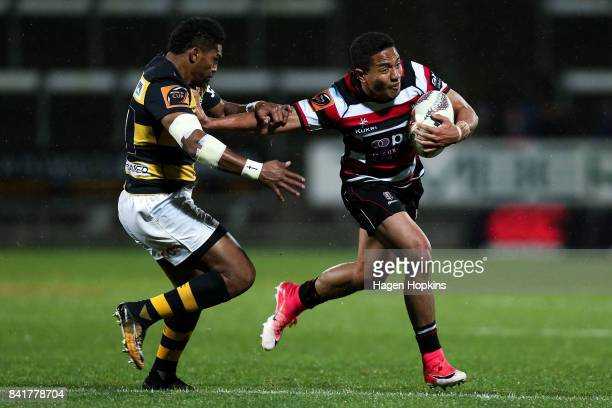 Luteru Laulala of Counties Manukau attempts to evade the tackle of Waisake Naholo of Taranaki during the round three Mitre 10 Cup match between...
