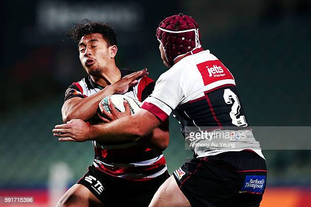 Luteru Laulala of Counties Manukau clashes into James Parsons of North Harbour during the round one Mitre 10 Cup match between North Harbour and...