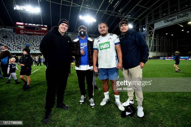 Luteru Tolai of the Blues poses for a photo with fans following the round eight Super Rugby Aotearoa match between the Highlanders and the Blues at...