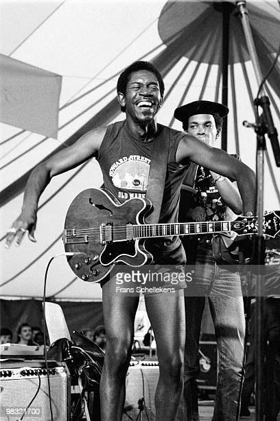 Luther Allison performs live on stage with Sugar Blue behind at the North Sea Jazz Festival in The Hague, Holland on July 14 1983